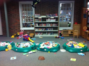 Ingenious placement of board books in turtle sandboxes in the middle of the room