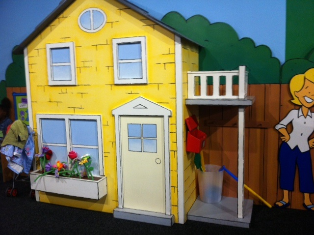Pretend house with removable flowers in window boxes