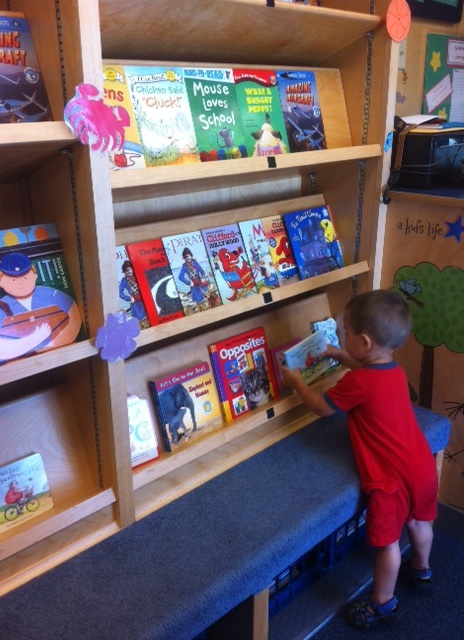 Choosing a book in the Storymobile