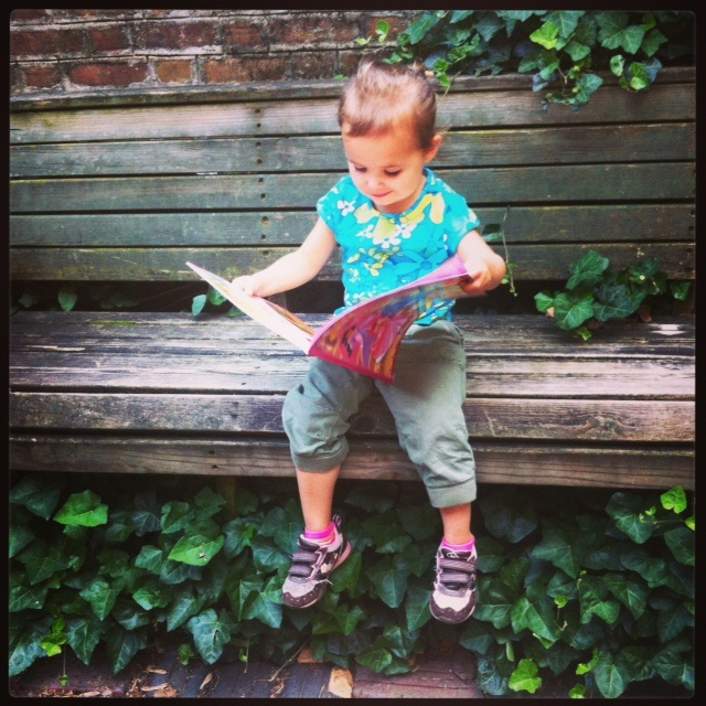 Reading her new book in the courtyard