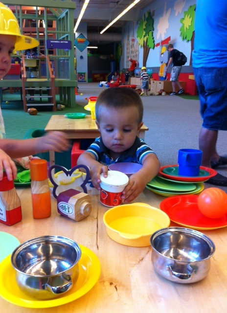 Playing in the pretend kitchen