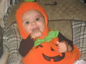 Our little pumpkin during her first Halloween!