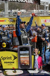 Krista and Jimmie Johnson, as he celebrates his victory for the STP Gas Booster 500 in Martinsville, Virginia. (Photo by Harold Hinson for Chevrolet)