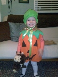 Adela in her Halloween costume (Mamma made her pumpkin hat and she's very proud of it!)
