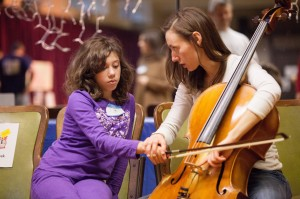 A Firefly Arts participant learning cello basics with Rachel Smith, Music Teaching Artist Photo credit: Stephanie Letzkus of Letzkus Photography