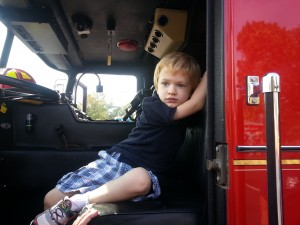 Rebecca's son, Jack, striking a pose at a local Touch-a-Truck event.
