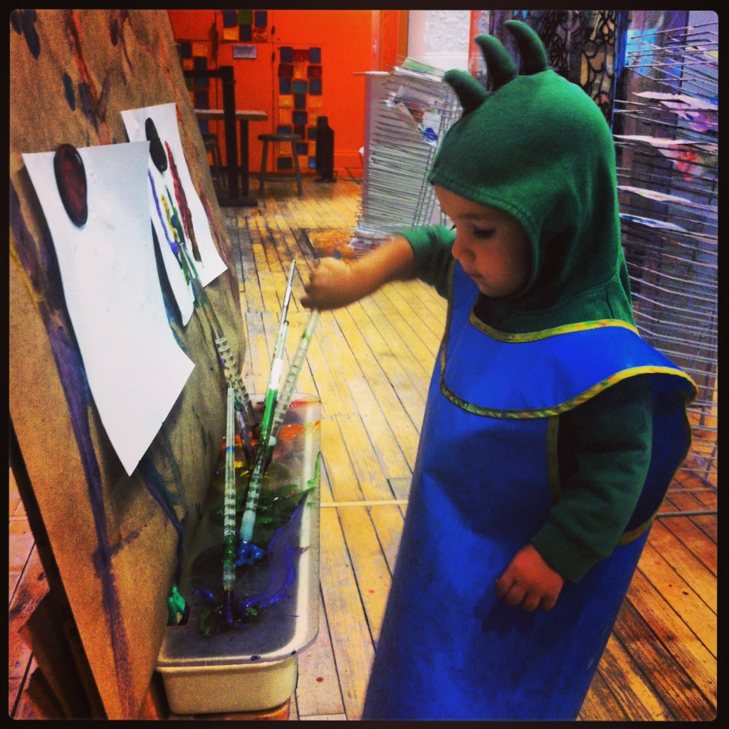 Painting in costume at the Children's Museum